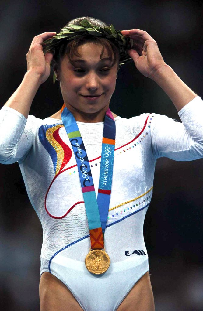 Monica Rosu of Romania smiles with her gold medal after the vault during the women's gymnastics individual apparatus finals at the 2004 Summer Olympic Games in Athens, 22 August2004.